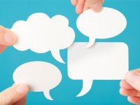 Four blank white speech bubbles
