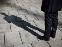Shadow of a businessman standing